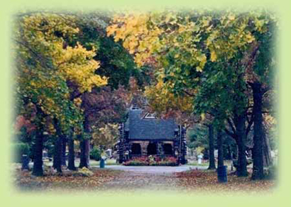The Riverside Cemetery Chapel, looking down a long grove in autum